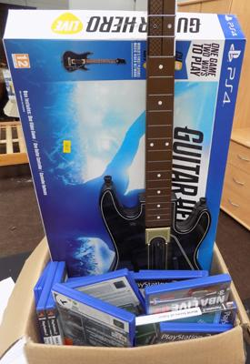 Box of PS2 games and 2 guitars