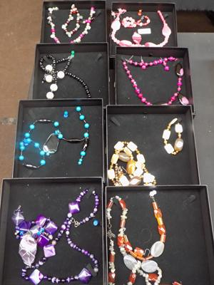 Eight boxed sets of jewellery