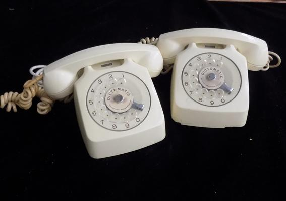 Two vintage Dictomatic dial telephones