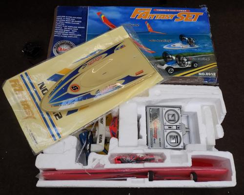 Two remote controlled sets Hobby Zone planes & 3 in 1 plane/boat/car - full W/O